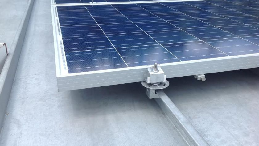 Solar Pro Uses the S-5! PV kit for this standing seam roof